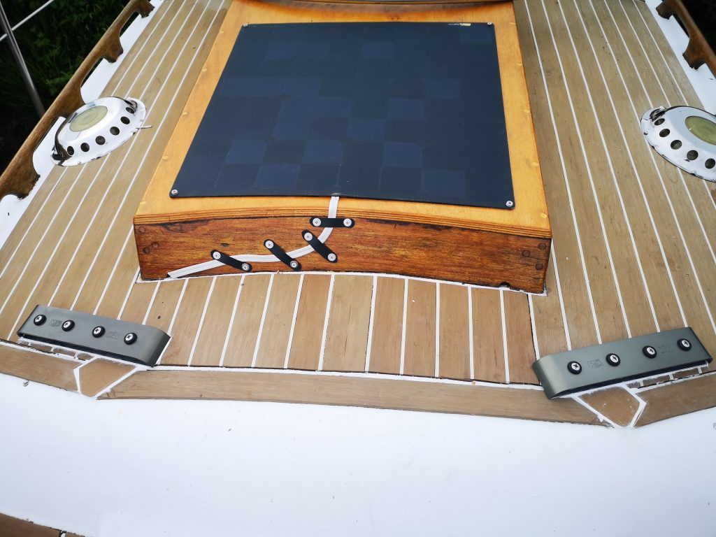 Solar panel on new hatch cover, and deck organisers
